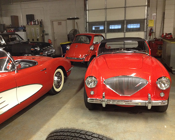 Three entirely different red classics from the same era: 1959 Corvette, 1958 BMW Isetta 300 and 1954 Austin-Healey 100.