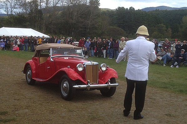 The MG TD leads the parade of winners before the crowd.