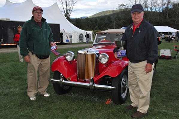 Ken Beck, owner of K&T Vintage, left, and Mike Jones with the 1950 MG TD.