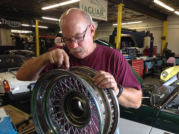 Parts manager George Libricz works on a wire wheel.